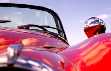 Old classic red jaguar at beach (shallow dof)
